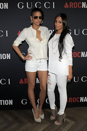 Cassie attended the Rocnation Pre-Grammy party wearing suede platform pumps with a slender ankle strap.