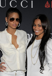 Cassie attended the Rocnation event wearing classic aviator shades in a dark brown tint.