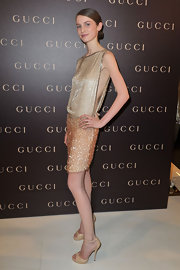 Tali Lennox looked divine at the Paris Vogue dinner in sleek nude snakeskin platform peep toes with delicate ankle straps.
