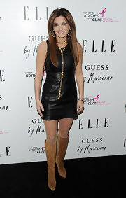 Beth Shak paired tan Christian Louboutin knee-high boots with her mini dress for a stylish retro look.