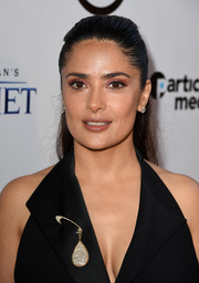 Salma Hayek styled her sexy LBD with a stunning diamond brooch for the screening of 'Kahlil Gibran's The Prophet.'