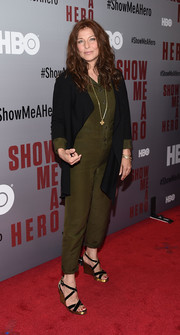 Catherine Keener pulled her outfit together with a pair of strappy black and gold wedges.