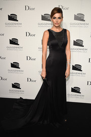 Camilla Bella exuded timeless elegance in a black Dior silk gown with a long train during the Guggenheim International Gala dinner.