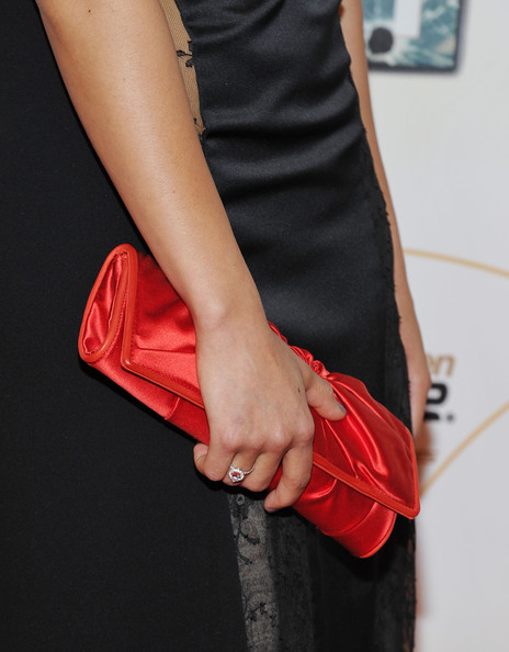 Gugu Mbatha-Raw Satin Clutch [red,clothing,dress,fashion,leather,arm,footwear,hand,shoulder,joint,touch,gugu mbatha-raw,premiere - arrivals,q a,detail,new york city,american museum of natural history,premiere]