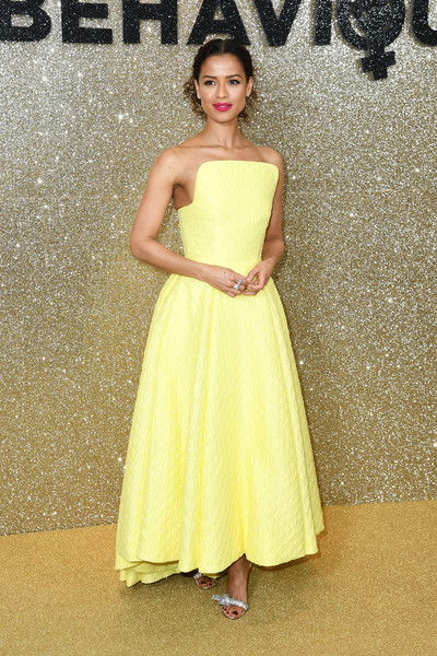 Gugu Mbatha-Raw Evening Sandals [dress,clothing,fashion model,yellow,bridal party dress,gown,shoulder,cocktail dress,a-line,strapless dress,red carpet arrivals,dress,gown,cocktail dress,party dress,gugu mbatha-raw,wedding dress,fashion,fashion model,misbehaviour world premiere,wedding dress,fashion,dress,gown,haute couture,cocktail dress,party dress,photo shoot,model,bride]