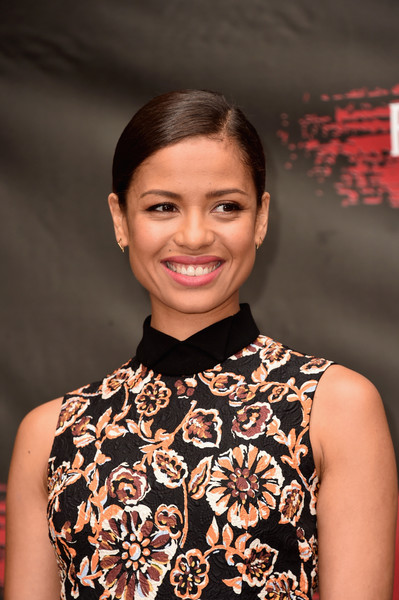 Gugu Mbatha-Raw Classic Bun [hair,beauty,hairstyle,fashion,premiere,smile,dress,fashion accessory,fashion design,gugu mbatha-raw,photo call,free state of jones,los angeles,beverly hills,california,four seasons hotel,stx entertainment]