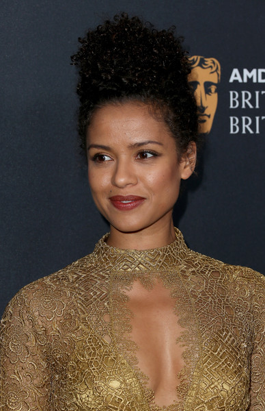 Gugu Mbatha-Raw Curly Updo [hair,face,hairstyle,eyebrow,beauty,lip,chin,black hair,forehead,dress,gugu mbatha-raw,arrivals,british academy britannia awards,the beverly hilton hotel,beverly hills,california,amd,american airlines,jaguar land rover,british academy]