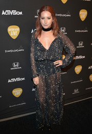 Ashley Tisdale looked seductive in a sheer black star-print maxi dress by LoveShackFancy during the Guitar Hero Live launch.