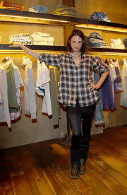 Asia Argento teamed up her plaid shirt with a pair of black tights.