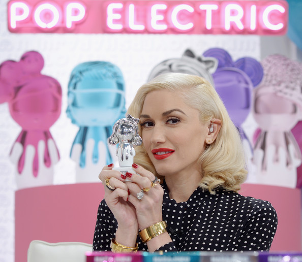 Gwen Stefani got all blinged up with gold bracelets on both wrists along with some rings.