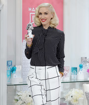 Gwen Stefani made mixed prints look so stylish with this black-and-white polka-dot blouse and grid-print pants combo at the debut of her new collection on HSN.