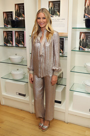 Gwyneth Paltrow kept the shine going with a pair of silver platform sandals by Jimmy Choo.