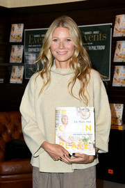 Gwyneth Paltrow shunned color for her book signing, pairing black nail polish with her neutral-toned outfit.