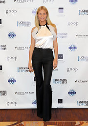 Gwyneth wore a white silk-charmeuse halter blouse with organza ruffles to the Licensing Expo in Las Vegas.