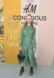 Kate Bosworth donned a green print midi dress for the celebration of the 2018 H&M Conscious Exclusive collection.