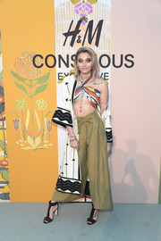 Paris Jackson teamed her top with a pair of olive-green palazzo pants.