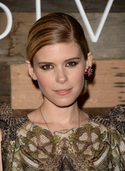 Kate Mara pulled her hair back into a simple side-parted ponytail for the H&M Conscious Collection dinner.