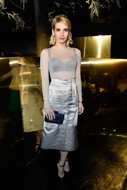 Emma Roberts accessorized with a textured metallic-blue clutch by Kotur for a splash of color.