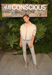 Hailey Baldwin matched her jacket with a pair of taupe suede pants.