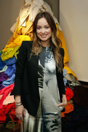 Olivia Wilde layered a black blazer over a print dress, both from the H&M Conscious Collection, for the brand's event.