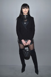 Kristina Bazan went for edgy styling with a studded leather purse and a pair of thigh-high boots.