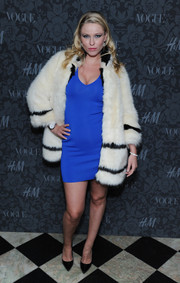 Kiera Chaplin teamed black pointy pumps with a body-con dress and a fur coat for the H&M and Vogue Studios Between the Shows party.