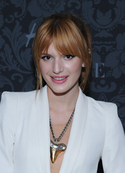 Bella Thorne wore her hair in a hip ponytail with center-parted bangs when she attended the H&M and Vogue Studios Between the Shows party.