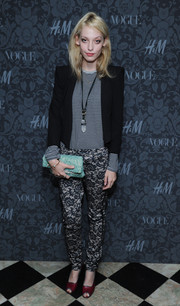 Cory Kennedy mixed prints with this striped shirt and floral pants combo at the H&M and Vogue Studios Between the Shows party.