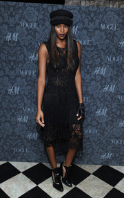 Damaris Lewis went for feminine elegance in a little black lace dress at the H&M and Vogue Studios Between the Shows party.