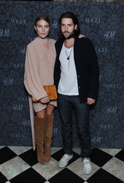 Dree Hemingway contrasted her feminine outfit with bold knee-high suede boots when she attended the H&M and Vogue Studios Between the Shows party.