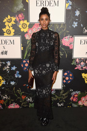 Imaan Hammam donned a lace and floral-print maxi dress for the Erdem x H&M runway show.