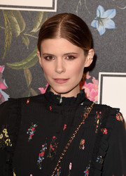 Kate Mara went for a simple center-parted updo when she attended the Erdem x H&M runway show.
