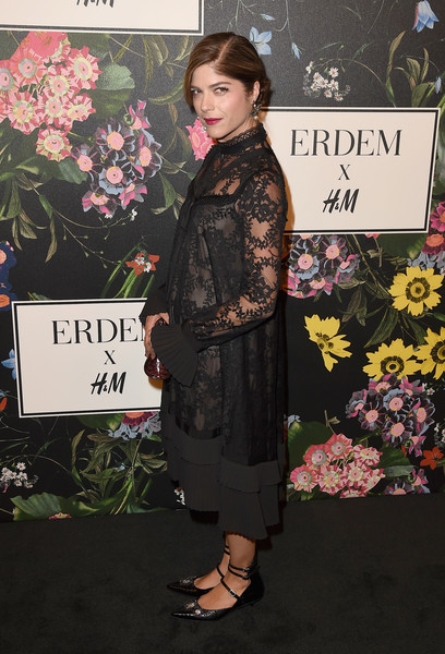 Selma Blair was classic and conservative in a loose black lace dress at the Erdem x H&M runway show.