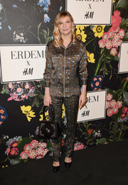 Kirsten Dunst jumped on the pajama bandwagon with this printed brown number at the Erdem x H&M runway show.