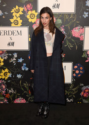 Rainey Qualley bundled up in a navy grid-print coat for the Erdem x H&M runway show.