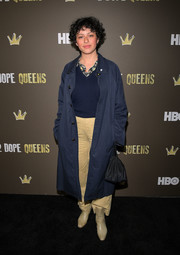 Alia Shawkat teamed a navy duster with a V-neck sweater and a pair of khakis for the '2 Dope Queens' slumber party premiere.