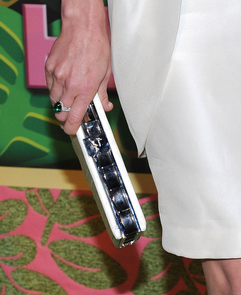 Anne Heche paired her white cocktail dress with a sparkling white clutch.