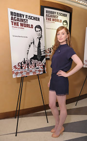 Lotte paired her blue blouse with lace shorts for the screening of 'Bobby Fischer Against the World.'