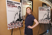 Lotte looked sophisticated at the screening of 'Bobby Fischer Against the World' in a blue silk blouse and matching shorts.