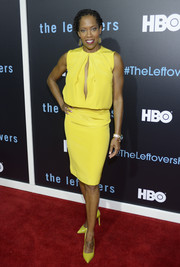 Regina King brightened up the red carpet in a neon-yellow dress with a slashed front during the 'Leftovers' season 2 premiere.