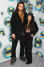 Lisa Bonet paired satin-trimmed black slacks with a cropped jacket for her menswear-inspired Golden Globes after-party look.