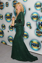 Laura Dern accented her sparkly emerald gown with an equally glittery black purse.