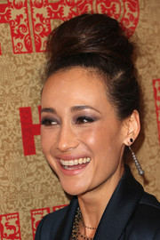 Maggie Q completed her look with a pair of tribal-inspired dangling earrings.
