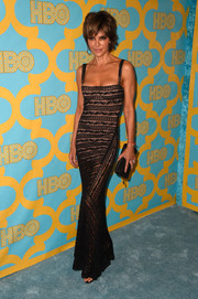 Lisa Rinna showed off her ageless figure in a body-con Alaia lace gown that she's already worn at an event 10 years ago.