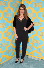 Nia Vardalos opted for a casual black sheer-panel jumpsuit, styled with a velvet wrap, for her HBO Golden Globes party look.