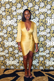 Tika Sumpter flaunted some serious curves at the HBO Golden Globes post-party in a ruched yellow dress with a plunging neckline and ruffle detailing.