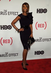 Iman gave a twist to the classic LBD at the premiere of 'The Lazarus Effect' with a ruffled shoulder design and large patent belt.