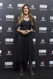 Sarah Jessica Parker kept it timeless in a black lace midi dress at the HBO Spain presentation party.