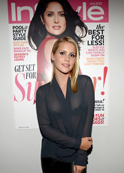 Claire Holt looked subtly daring in a sheer black blouse at the Elizabeth and James collection party.
