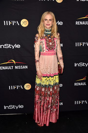 Nicole Kidman looked fetching in a mixed-print gown by Valentino at the HFPA and InStyle TIFF celebration.